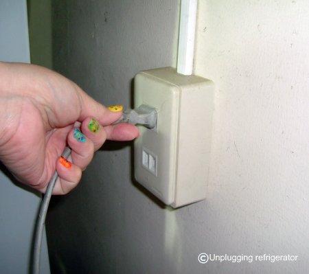 unplug refrigerator